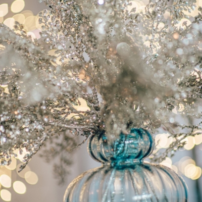<p>Blue glass cruet vase filled with eternal Christmas glittered white branches, sugar paper glass Christmas balls and ice effect pendants.<br>