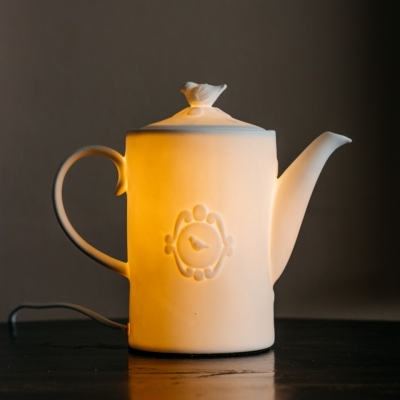 <p>Bright porcelain table teapot, bulb excluded.<br>